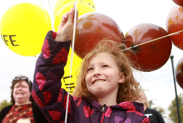 10-7-12<br /> Balloon release<br /> Maggie Houlahan, 8, releases balloons for Respect Life Sunday at St. Patrick Catholic Church.<br /> KT photo | Kelly Lafferty