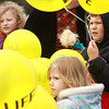 10-7-12<br /> Balloon release<br /> Siblings Maggie Houlahan, 8, Charlie Houlahan, 8, and Johannah Houlahan, 3, wait outside St. Patrick Catholic Church to release balloons for Respect Life Sunday.<br /> KT photo | Kelly Lafferty
