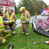 10-4-12<br /> Greentown volunteer firefighters work for about 45 minutes to free a woman from a single car accident on 100 North about 800 East. The woman is believed to have lost control while trying to avoid hitting 2 kids crossing the street.<br /> KT photo | Tim Bath