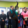 10-27-12<br /> Jack-o-lantern jog<br /> Erin Larison judges the Jack-o-lantern jog's costume contest by audience applause inside the YMCA on Saturday morning.<br /> KT photo   Kelly Lafferty