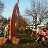10-25-12<br /> Pumpkin patch<br /> Emily Willis, 8, Abrie Pentland, 6, and Sierra Pentland, 10 race to reach a bean bag to toss through the pumpkin at the pumpkin patch off of Jefferson, while Alyssa Willis, 8, throws the bean bags back to them from behind the pumpkin.<br /> KT photo   Kelly Lafferty