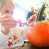 10-20-12 <br /> The Kokomo Parks & Recreation Department hosted at Pumpkin painting event at the Kirkendall Nature Center at Jackson Morrow Park on Saturday.<br /> Bonnie Lange, 73, painting a pumpkin along with her family.<br /> KT photo | Tim Bath
