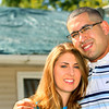 9-31-12 <br /> Kristina and Jason Vazquez in front of the leaky roof on their house. A tarp was placed over the roof as a temporary measure to stop the leaks.<br /> KT photo | Tim Bath