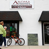 10-3-12<br /> Aroma Coffeeshop<br /> Ladies walk by the storefront of Aroma, a new coffeeshop in downtown Peru.<br /> KT photo | Kelly Lafferty