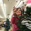10-28-12<br /> We Care Trim-A-Tree decorating<br /> Ricque Roberts adjusts the tree decorations as she participates in the We Care Trim-A-Tree decorating event on Sunday.<br /> KT photo | Kelly Lafferty