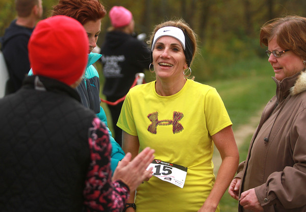 10-13-12<br /> Run the Shores<br /> Denise Bradley is congratulated after being the first woman to cross the finish line in Run the Shores 5K on Saturday morning.<br /> KT photo | Kelly Lafferty
