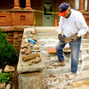 9-30-13  --- Jim Fisher, 87 year-old WWII vet and a mason, working on rebuilding the stone walls of the Seiberling Mansion.<br />   KT photo | Tim Bath