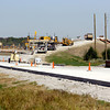 9-26-13  --- Crews pour contrete roadway up to the bridge over the new US31 at the interchange of the old US31 at the north end of town.<br />   KT photo | Tim Bath
