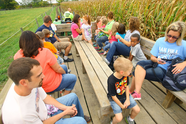 10-4-13  --  Converse Elementary student riding the hay ride past the corn maze at Guffey Acres<br />   KT photo | Tim Bath