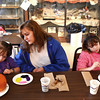 10-19-13<br /> Pumpkin painting at Kirkendall Nature Center<br /> Kristi Goley (center) watches as her daughters Erin (left) and Tiffany paint pumpkins at Kirkendall Nature Center.<br /> KT photo | Kelly Lafferty