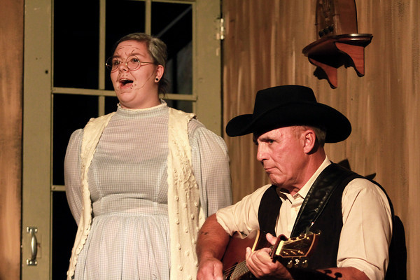 10-4-13<br /> Ole Olsen: Of Mice and Men<br /> Aunt Clara, played by Sarah Holtzlander and Boss, played by Duane Flaherty sing and play the guitar in between scenes of Of Mice and Men at Ole Olsen Memorial Theatre.<br /> KT photo   Kelly Lafferty