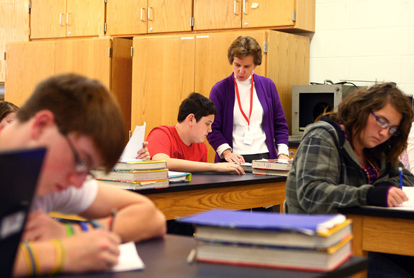 10-24-13<br /> Maconaquah teacher Eileen Johns<br /> Eileen Johns helps Brady Hiles on his Algebra problems at Maconaquah High School.<br /> KT photo | Kelly Lafferty