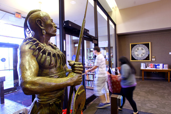 "10-16-13  --  Bronze native american statues at Tipton Library. ""Prairie Soldier"" by sculptor Hollis Williford<br />   KT photo 