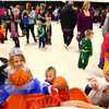 10-26-13<br /> Community Halloween Party  <br /> Daire Short (right) helps Geordyn Meacham (left) and Aydan Short play one of the games set up in the Event Center for the community halloween party on Saturday.<br /> KT photo | Kelly Lafferty