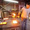 10-16-13  --  Chris Wilcox pours glass in moulds at Kokomo Opalescent Glass factory<br />   KT photo | Tim Bath