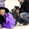 10-26-13<br /> Community Halloween Party  <br /> Harmony Davis reacts after seeing people dressed in scary costumes, as Travis Davis puts on her boots at the community halloween party on Saturday.<br /> KT photo | Kelly Lafferty