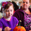 10-19-13<br /> Pumpkin painting at Kirkendall Nature Center<br /> Abby Defoi paints a pumpkin at Kirkendall Nature Center as her mom Audrey Bowman watches.<br /> KT photo | Kelly Lafferty