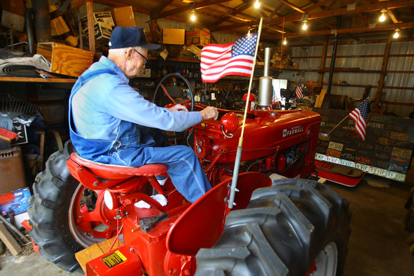 10-2-13  --   Meredith Kingery and his wife June have lived on north Wabash since 1947. Firing up the old Farmall tractor.<br />   KT photo | Tim Bath