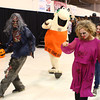 10-26-13<br /> Community Halloween Party  <br /> Ghoulish characters, along with the Little Caesars mascot dance to the Cupid Shuffle on Saturday during the community halloween party.<br /> KT photo | Kelly Lafferty