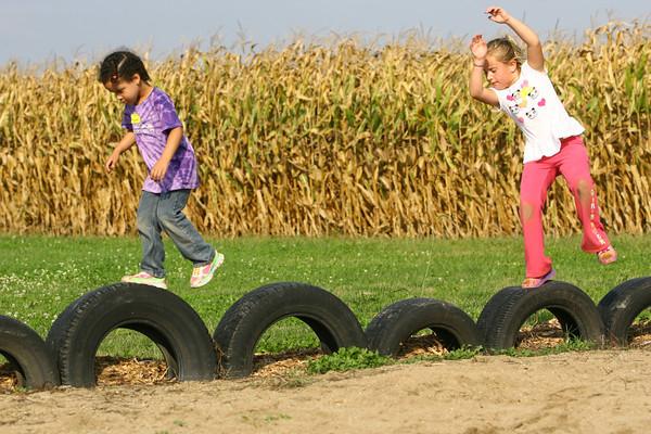10-4-13  --  Abigail Foutcher, 4, and Gracie Estok, 7, on a field trip with Childrens Christian Academy, Guffey Acres<br />   KT photo | Tim Bath