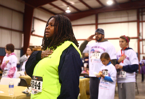 10-19-13<br /> Follow Me...Neil's Next Mission 5K<br /> Stephanie Oden sings along to the National Anthem before the start of Follow Me...Nei'ls Next Mission 5K on Saturday morning.<br /> KT photo | Kelly Lafferty