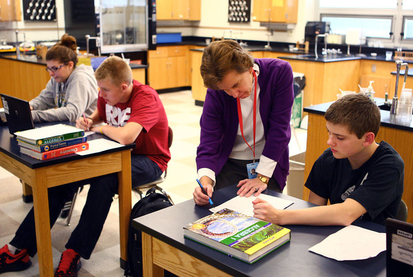 10-24-13<br /> Maconaquah teacher Eileen Johns<br /> Dakota Howell receives help in his Algebra class at Maconaquah High School from his teacher Eileen Johns.<br /> KT photo | Kelly Lafferty