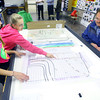10-30-13  --  Lego League Central Middle School students Jerzie Eagle and Liesel Elkins do a presentation to the City of Kokomo's Don Cree on how the city could use property in the flood plan across the creek from the school.<br />   KT photo | Tim Bath