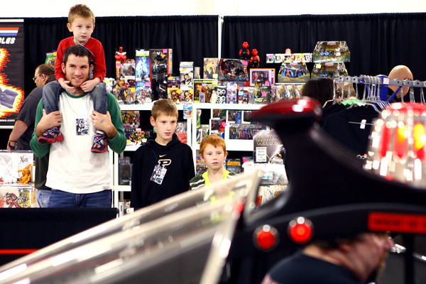 10-19-13<br /> Kokomo-Con<br /> Shane miller (left) along with Kreed, Korbin, and Kamp Miller, get a look at the Batmobile at Kokomo-Con on Saturday.<br /> KT photo | Kelly Lafferty