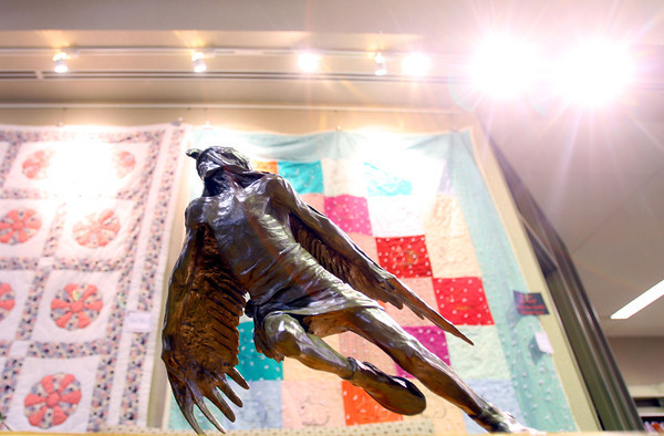 """10-16-13  --  Bronze native american statues at Tipton Library. This is """"Eagle Shadow,"""" by sculptor Hollis Williford.<br />   KT photo 