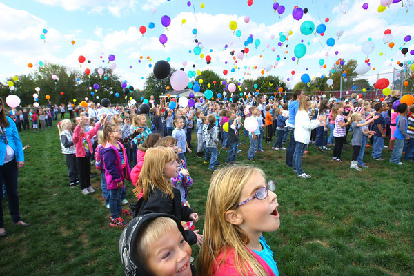 10-18-13  --  Western Primary School kids launch 1500 balloons in memory of Mason Hopkins who a student who died of brain cancer. Haiden Felton and Jaycee Holt watch as the balloons take off.<br />   KT photo | Tim Bath