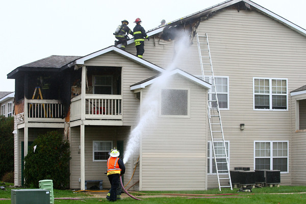 10-22-13<br /> Firefighters respond to a fire at Summerset Apartments on Tuesday afternoon.<br /> KT photo | Kelly Lafferty
