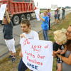 10-3-13  --   Non-essential personel picket in front of the Grissom Air Reserve Base and US31 entrance to the aeroplex. Matthew Christopher, Crystal Painter and her son Conner Moore protesting at the entrance to the Grissom Aeroplex along with other employees and family members.<br />   KT photo | Tim Bath
