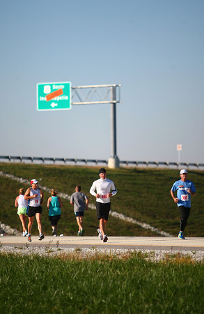 10-12-13<br /> Highway Half Marathon and 5K<br /> Highway Half Marathon runners run north on the new bypass after the reached the 5.5 mile marker near Ind. 26.<br /> KT photo | Kelly Lafferty