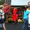 10-5-13<br /> Oktoberfest-Chili Cook Off<br /> Becca Glassburn, dressed like a chili pepper, dances in front of one of the vendor tents during Peru's Oktoberfest on Saturday.<br /> KT photo | Kelly Lafferty