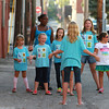 10-4-13<br /> First Friday October<br /> Members of Girl Scout troop 4119 sing songs near their bake sale during First Friday.<br /> KT photo | Kelly Lafferty