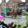 7-19-14<br /> Circus Parade<br /> The circus parade passes through downtown Peru on Saturday morning.<br /> Kelly Lafferty | Kokomo Tribune