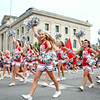 7-19-14<br /> Circus Parade<br /> Maconaquah High School cheerleaders lead a chant as they pass by the Miami County Courthouse in the Peru Circus City Festival parade.<br /> Kelly Lafferty | Kokomo Tribune