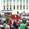 7-19-14<br /> Circus Parade<br /> Parade-goers watch a calliope in Peru's circus parade on Saturday morning.<br /> Kelly Lafferty | Kokomo Tribune