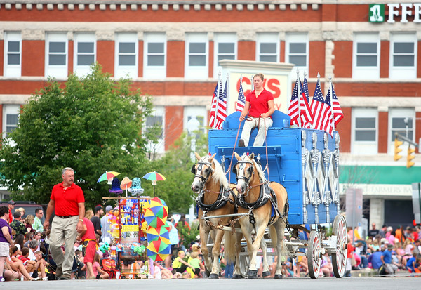 7-19-14<br /> Circus Parade<br /> The streets in downtown Peru are line with people as they watch the circus parade come through on Saturday morning.<br /> Kelly Lafferty | Kokomo Tribune