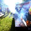 6-13-14 -- Tom Rohrer cooking up slabs of ribs for Hog Heaven at Ribfest 2014.    ---<br /> Tim Bath   Kokomo Tribune