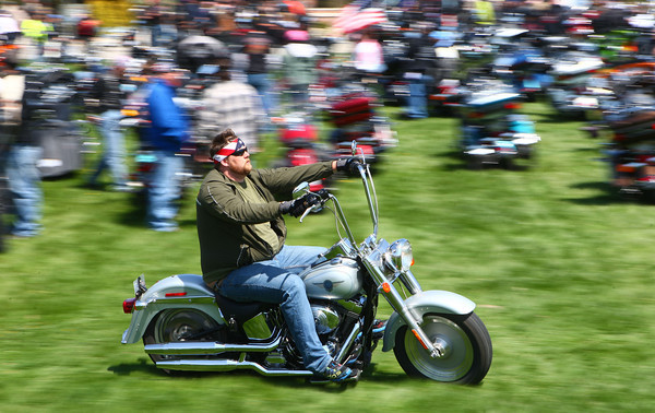 4-27-14<br /> Ride for Troops<br /> A motorcyclist makes his way into Darrough Chapel Park on Sunday afternoon for Ride for Troops.<br /> Kelly Lafferty | Kokomo Tribune