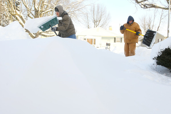 1-6-14   --- Heavy snow blanketed Kokomo and surrounding areas with cold temp below zero. Matt Powell and Mark Grubb shovel a driveway on King Street that had drifts a high a 3 feet. -- <br />   KT photo | Tim Bath