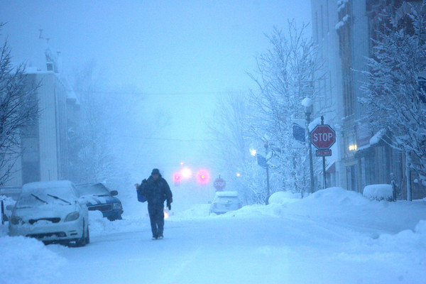 1-5-14   --- Heavy snow blanketed Kokomo and surrounding areas. Albert Schwenger III walks home east on Walnut Street downtown from the store were he went to get bread and other food items shortly after dusk. -- <br />   KT photo | Tim Bath