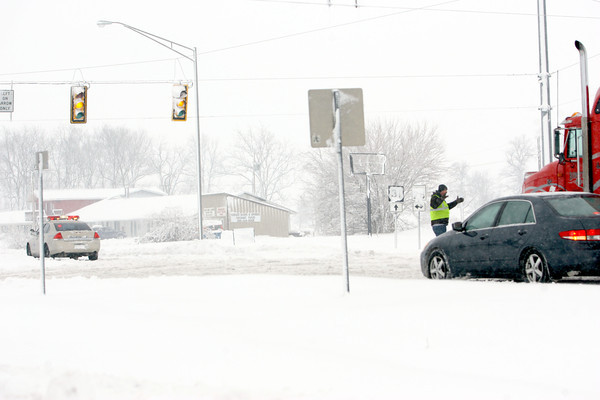 1-5-14   --- Heavy snow blanketed Kokomo and surrounding areas. Tipton County EMA officer directs traffic east and west at Ind 28. US 31 was closed due to a tanker overturned a few miles south on US 31. -- <br />   KT photo | Tim Bath