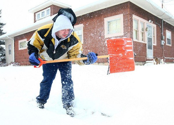 1-2-14<br /> Russell Lewellen shovels snow in front of his home on Havens Street on Thursday afternoon.<br /> KT photo | Kelly Lafferty