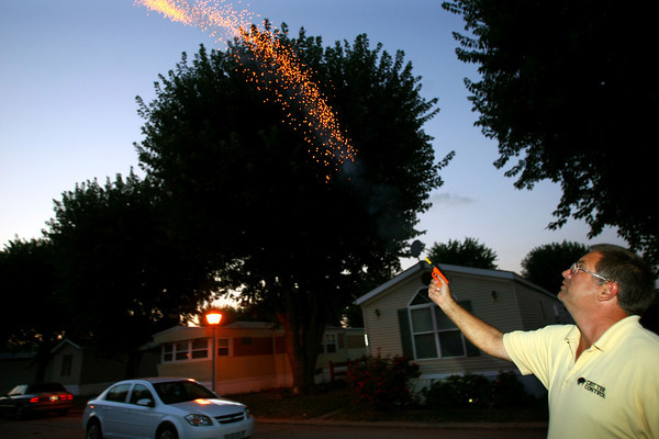 8-29-13  --  Tim Dale, owner of Critter Control, fires off a noise and flare gun that is designed to scare birds away at Holiday Trailer Park on north Apperson Way on Thursday evening. The thousands of small black birds were swarming to the trees for the night.<br />    KT photo | Tim Bath