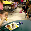 9-6-13  --  School lunchtime at Lafayette Park Elementary School. Dylan Walker takes a bite of his Stromboli Bread Bowl after he picked off the meat. Still on his plate are the steamed broccoli, buttered corn and grapes. <br />    KT photo | Tim Bath