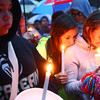 9-15-13<br /> Christian Reede candlelight vigil<br /> From left: Mecca Johnson, Adri Gonzalez, and Alexis Clark, mourn the loss of their classmate, Christian Reede, during the candlelight vigil on Sunday night.<br /> KT photo | Kelly Lafferty