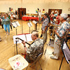 9-1-13<br /> Swampwater Stompers 20th Anniversary<br /> Attendees of Swampwater Stompers' 20th Anniversary celebration dance in a line as the band plays.<br /> KT photo | Kelly Lafferty