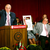 9-18-13  --  IUK Dedication of the Milt and Jean Cole Family Wellness and Fitness Center on Wednesday. Michael McRobbie, President of IU, holds up a key to the fitness center as he officially names the new fitness center. Milt and Jean Cole watch from their seats on the stage.<br />    KT photo | Tim Bath